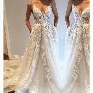 Unworn Wedding Dress.